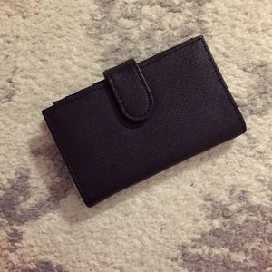 Compact black leather foldover snap wallet